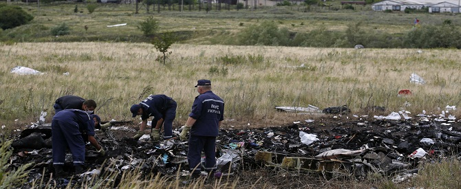 Members of the Ukrainian Emergencies Ministry work at a crash site of Malaysia Airlines Flight MH17, near the village of Hrabove