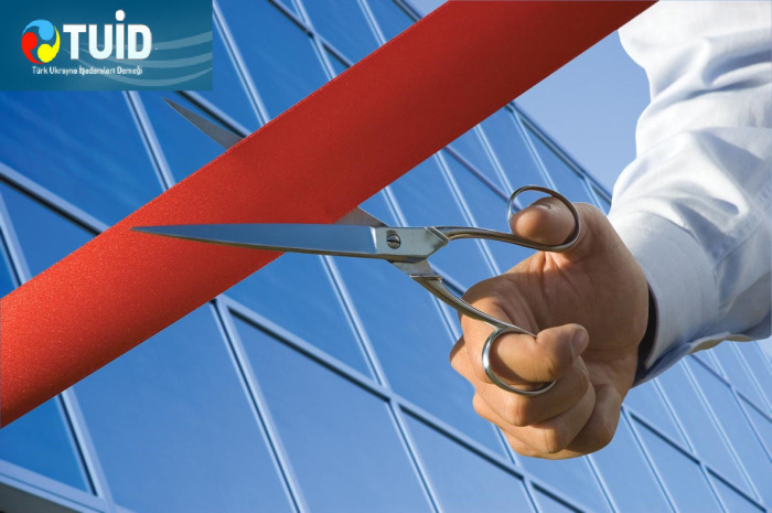red-ribbon-cutting-with-a-pair-of-scissors