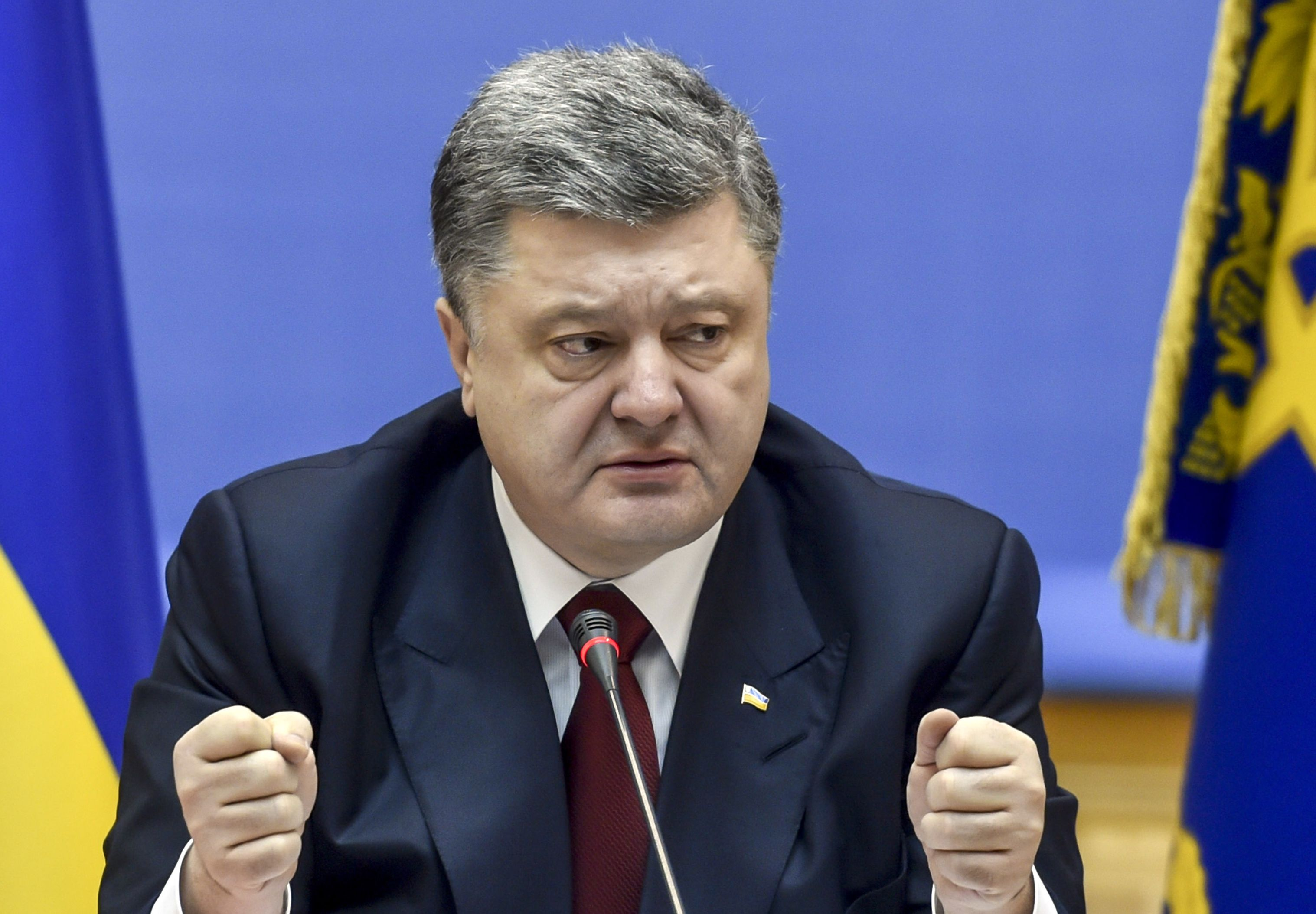 Ukrainian President Petro Poroshenko speaks during a cabinet meeting in Kiev, Ukraine, Wednesday, Feb. 11, 2015. On Wednesday French President Francois Hollande and German Chancellor Angela Merkel will go to the Belarusian capital of Minsk for the crucial talks on conflict in Ukraine's east with the presidents of Russia and Ukraine. (AP Photo/Mykola Lazarenko, Pool)