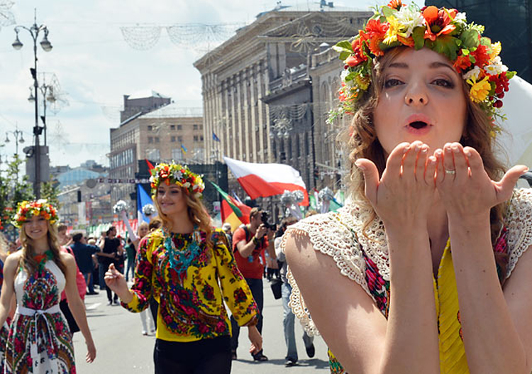 A girl blows a kiss as she takes part in a parade at the Euro 2012 football championsships fan zone in Kiev during it official opening on June 8, 2012, few hours before the Euro 2012 football championships opening.  AFP PHOTO/ SERGEI SUPINSKYSERGEI SUPINSKY/AFP/GettyImages