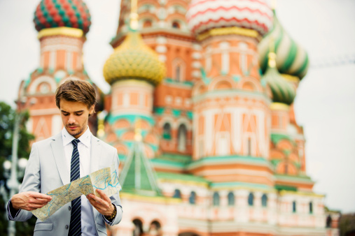 Handsome Young Businessman in Moscow holding street map