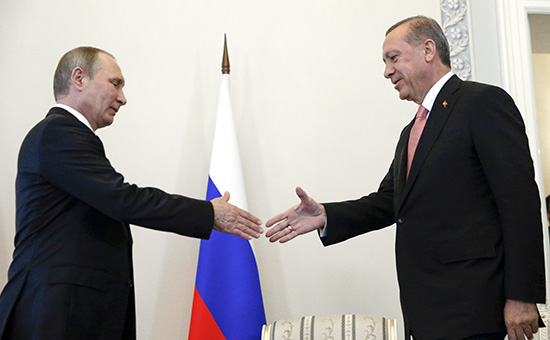 Russian President Vladimir Putin, left, welcomes Turkish President Recep Tayyip Erdogan in the Konstantin palace outside St.Petersburg, Russia, on Tuesday, Aug. 9, 2016. President Erdogan travels to Russia to meet with President Putin for the first time since apologizing in late June for the downing of a Russian fighter jet along the Syrian border in November last year. (AP Photo/Alexander Zemlianichenko)